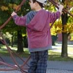 Child climbing at playground — Stock Photo #34072795