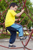 Child climbing at playground — Stock Photo