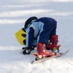 Child learning skiing — Stockfoto