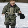 Child walking in snow — Stock Photo