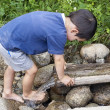 Child at  water stream — Stock Photo