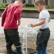 Children playing with water fountain — Stock Photo