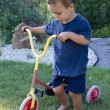 Child with tricycle — Stock Photo