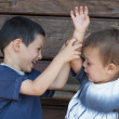 Stock Photo: Children fighting, sibling rivalry