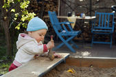 Child playing at sandbox — Stock Photo
