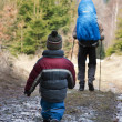 Child hiking with father — Stock Photo