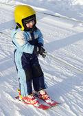 Child skier on ski lift — Stock Photo