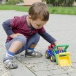 Child palying with toy car — Stock Photo #38721319