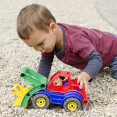 Child palying with toy car — Stock Photo