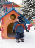 Child in winter playground — Stock Photo
