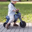 Постер, плакат: Child on toy bike