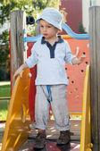 Child on slide at playground — Stock Photo