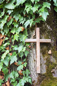 Wooden cross on tree — Stock Photo
