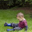 Child playing in grass — Stock Photo #40946701