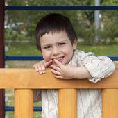 Happy child at playground — Stock Photo