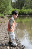 Children by a river — Stock Photo