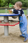 Child playing at playground — Stockfoto