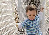 Child at adventure playground — Stock Photo