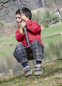 Child on swing — Stock Photo