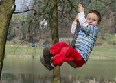 Child on swing — Stok fotoğraf
