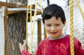 Child at adventure playground — Stockfoto