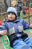 Children on chain swing — Stock Photo