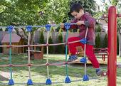 Child playing at playground — Stock Photo