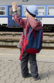 Child at train station — Stock Photo