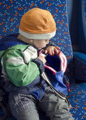 Child with backpack on train. — Stock Photo