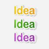 Paper clipped sticker: word idea — Stockvector