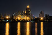 City Downtown at Night with Building Reflection in the River. — Stock Photo