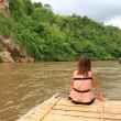 Woman Relaxing on a Bamboo Raft Floats on Kwainoi River with Wild landscape in Kanchanaburi, Thailand. — Stock Photo #42035971
