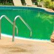 Swimming Pool with Stair at Hotel Close Up. — Stock Photo #42036027