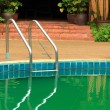 Swimming Pool with Stair at Hotel Close Up. — Stock Photo #42036033
