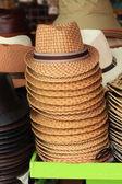 Stacks of Straw Hats at Shop. — Stock Photo
