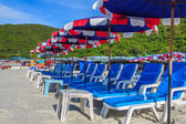 Deck Chairs and Colorful Umbrella on the Beach in Sunny Day ,Pat — Stock Photo