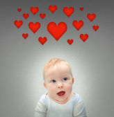Baby with hearts — Stock Photo