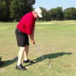 Stock Video: Golf lesson. Practicing golf. Out door activity.
