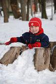 The boy in the winter sitting inside hemp — Stock Photo