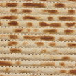 Texture of jewish passover matzah (unleavened bread) - Stock Photo