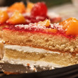 Cherries and peaches sponge cake with cream - Stock Photo