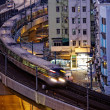 Very high-speed train go through HongKong financial center — Stock Photo #37928125