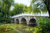 Stone bridge in an Asian garden — Stock fotografie