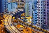 Very high-speed train go through the HongKong financial center — Stock Photo