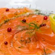 Salmon carpaccio with pink pepper — Stock Photo