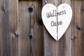 Wooden fence and wellness signboard — Stock Photo