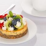 Cheese-cake, strawberry, blueberry and kiwi — Stock Photo