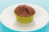 Muffin on plate — Stock Photo