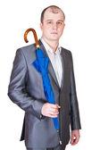 A man with a closed umbrella — Stock Photo