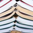 Stack of open books — Stock Photo #23281110